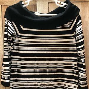 black and white sweater with flared sleeves